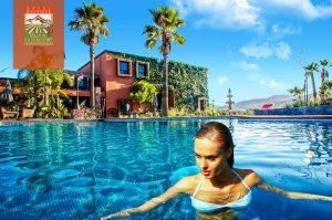 Girl swimming in the hotel pool